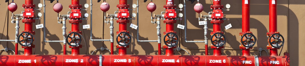 photo of industrial fire sprinkler system pipes with different zones